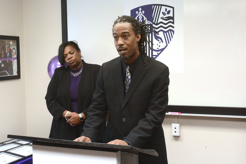 Shakaar Z. Johnson of the Smith Family Foundation  talks about the foundation's mission before board members gave out grants to a dozen Trenton non-profits. <br /> John Berry - The Trentonian