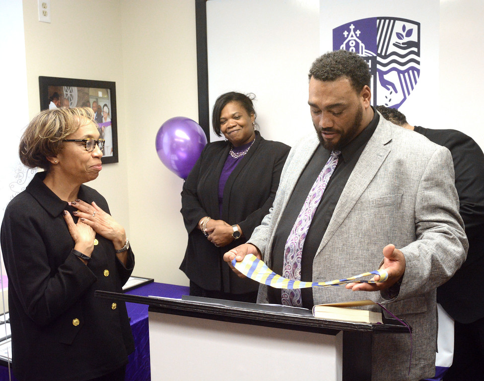 . Seamon Smith presents a grant to UIH Family Partners and tells a story about how the group helped him through hard times by giving him the tie he�s holding and help with a resume that got him on the path to gainful employment. John Berry - The Trentonian
