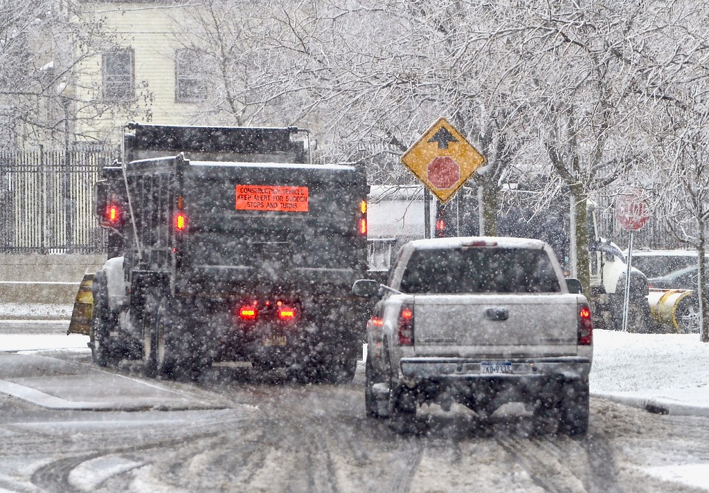 . A snow plow turns onto the soutbound side of Route 29 in Trenton during a winter storm on Wednesday afternoon. (Kyle Franko/ Trentonian Photo)