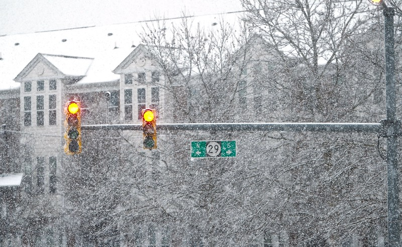 A light sits on red as snow falls all around on Route 29 in Trenton during a winter storm on Wednesdady afternoon. (Kyle Franko/ Trentonian Photo)