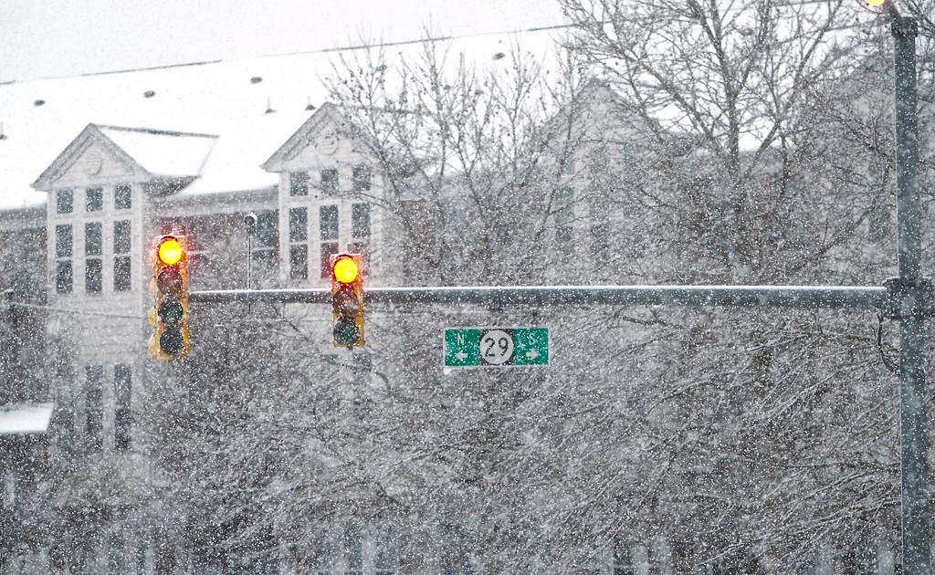. A light sits on red as snow falls all around on Route 29 in Trenton during a winter storm on Wednesdady afternoon. (Kyle Franko/ Trentonian Photo)