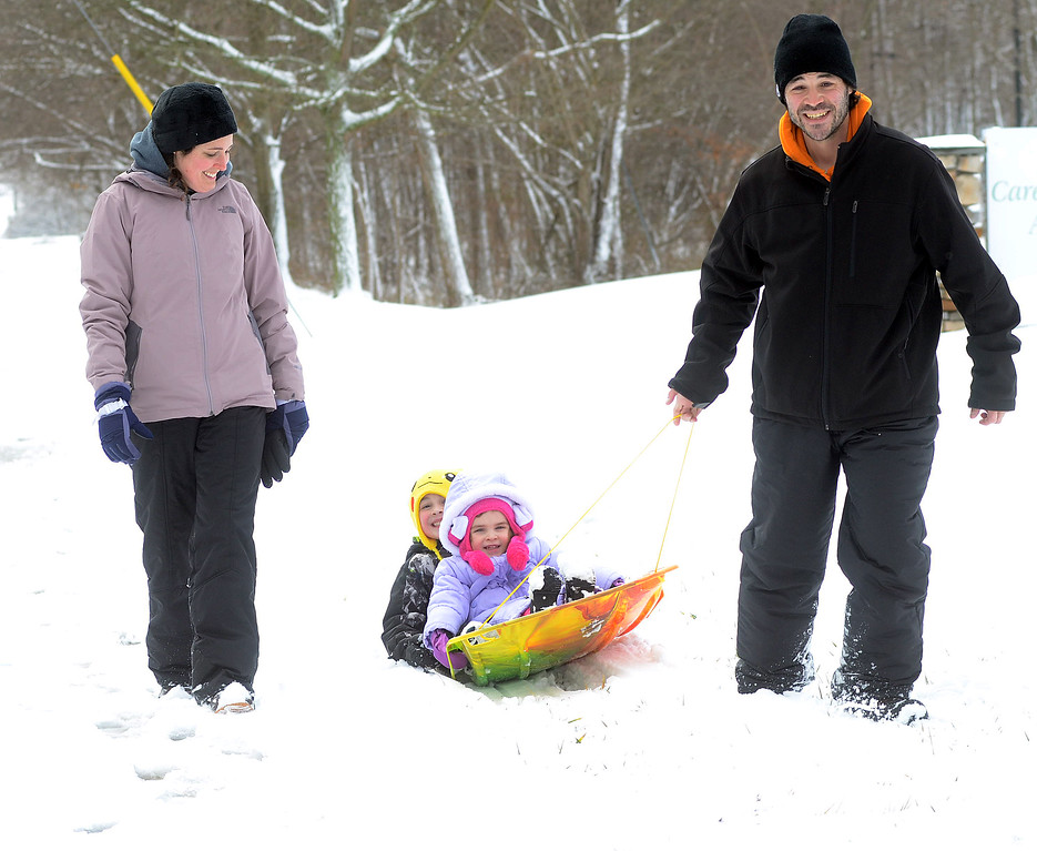 . The Lopez family enjoy the snow as they walk along Hamilton Square-White Horse Rd in Hamilton. gregg slaboda photo