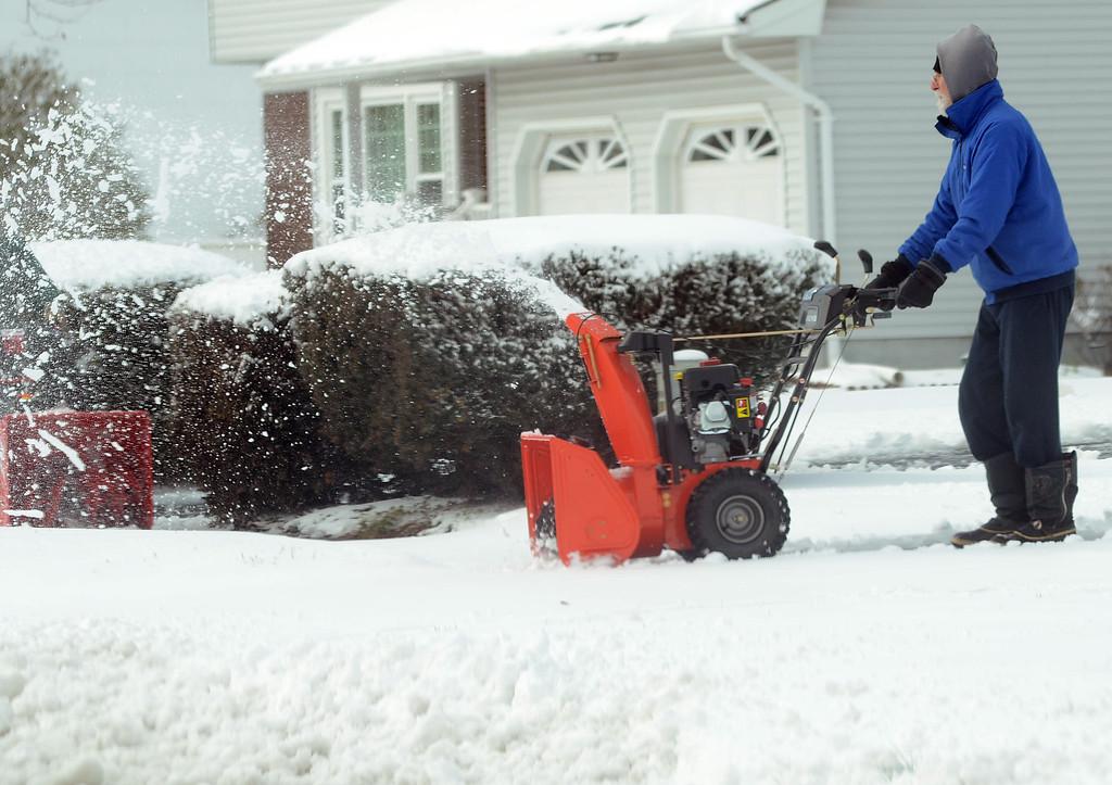. A man uses his snowblower on Roslyn Rd in Hamilton. gregg slaboda photo