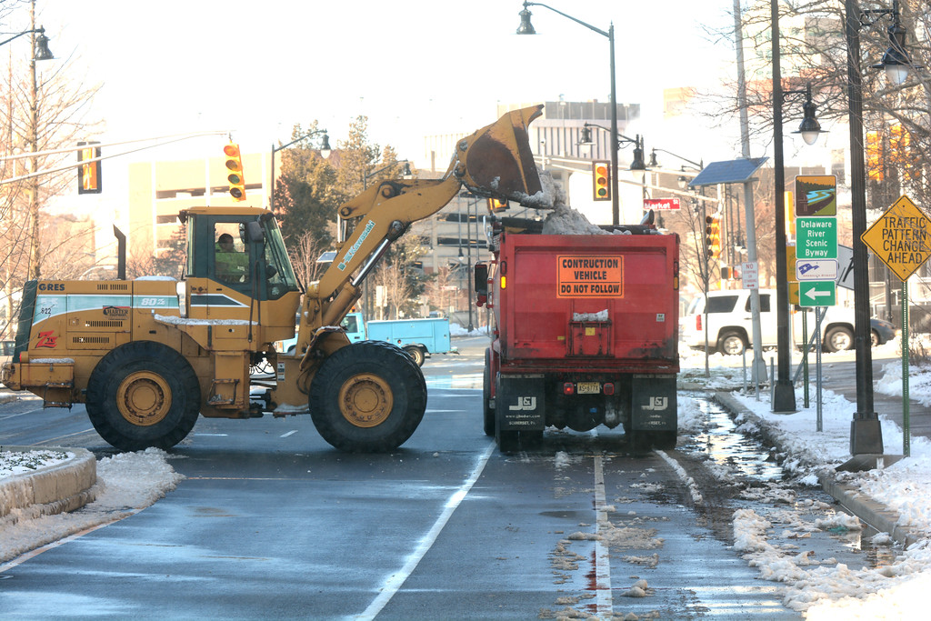 . City crew work on removing snow after Thursday�s storm dumped a few inches of snow on Trenton.John Berry - The Trentonian