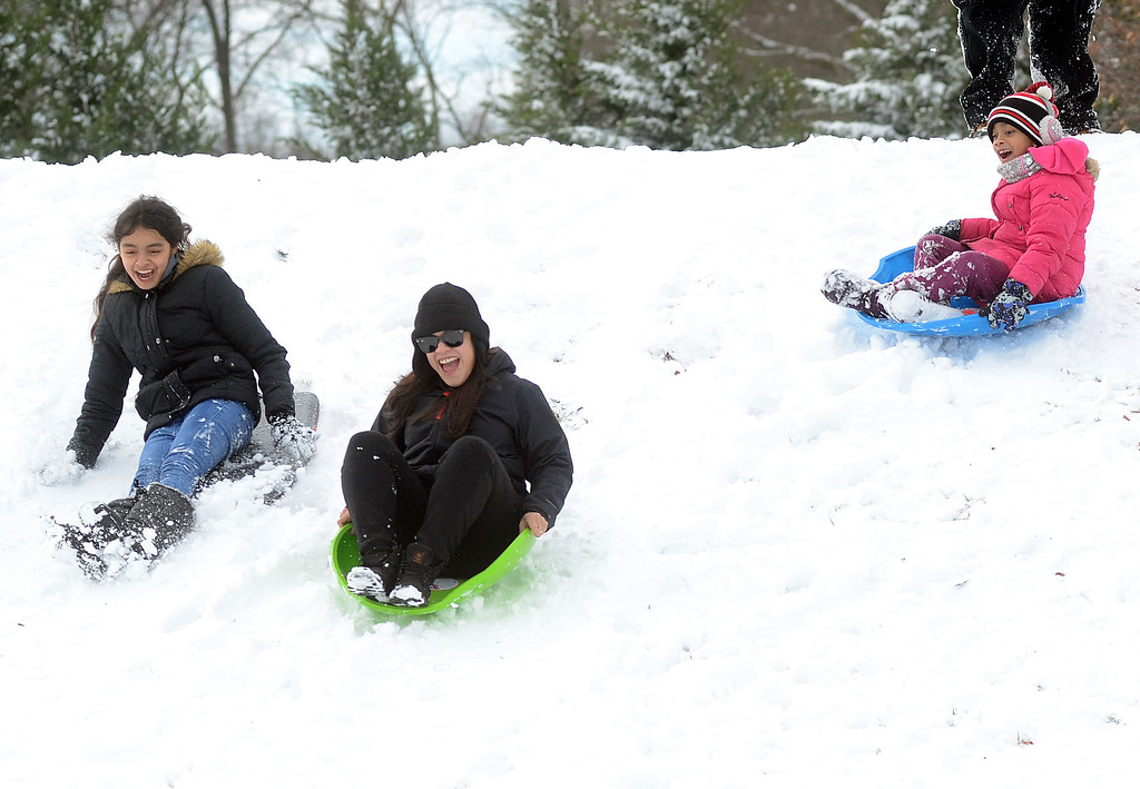 . Kids enjoy the snow in Veterans Park in Hamilton. gregg slaboda photo