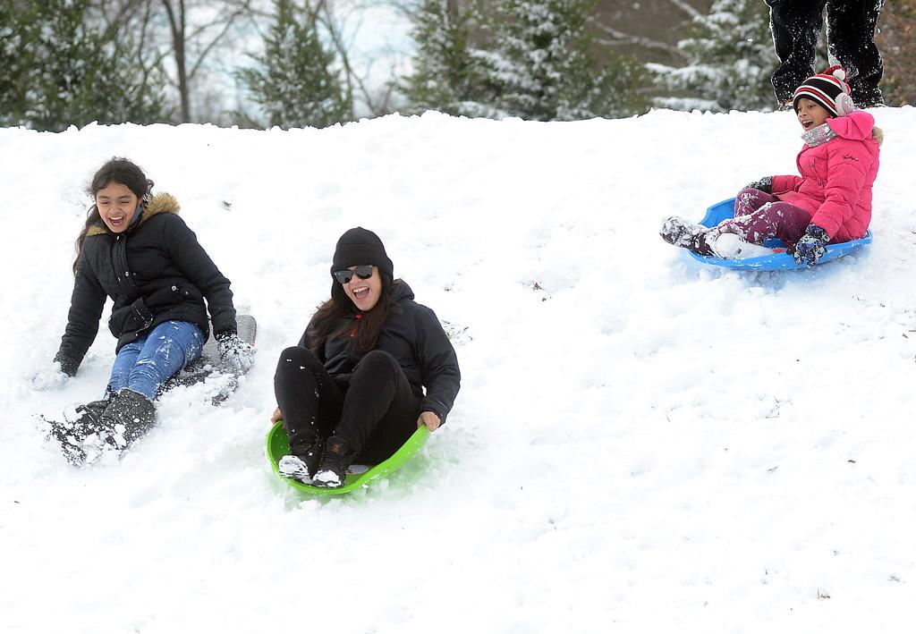 . Kids enjoy the snow in Veterans Park in Hamilton. gregg slaboda photo