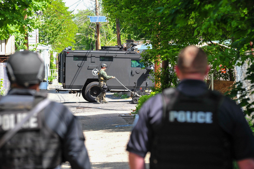 . New Jersey State Police  TEAMS unit officers are seen on Hills Place where a man had barricaded himself inside a Centre Street home after a shootout with police on May 10, 2017. (Scott Ketterer - The Trentonian)