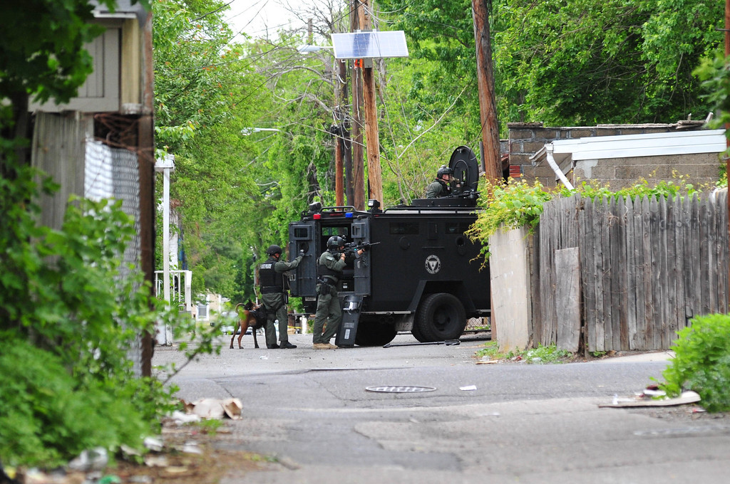 . New Jersey State Police  TEAMS unit officers are seen at the rear of 343 Centre Street where a man had barricaded himself inside after a shootout with police on May 10, 2017. (Scott Ketterer - The Trentonian)