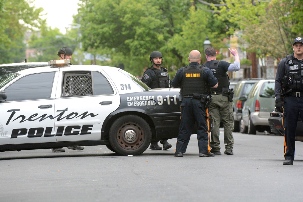 . Law enforcement officers block the road as the Trenton standoff neared an end Thursday. 