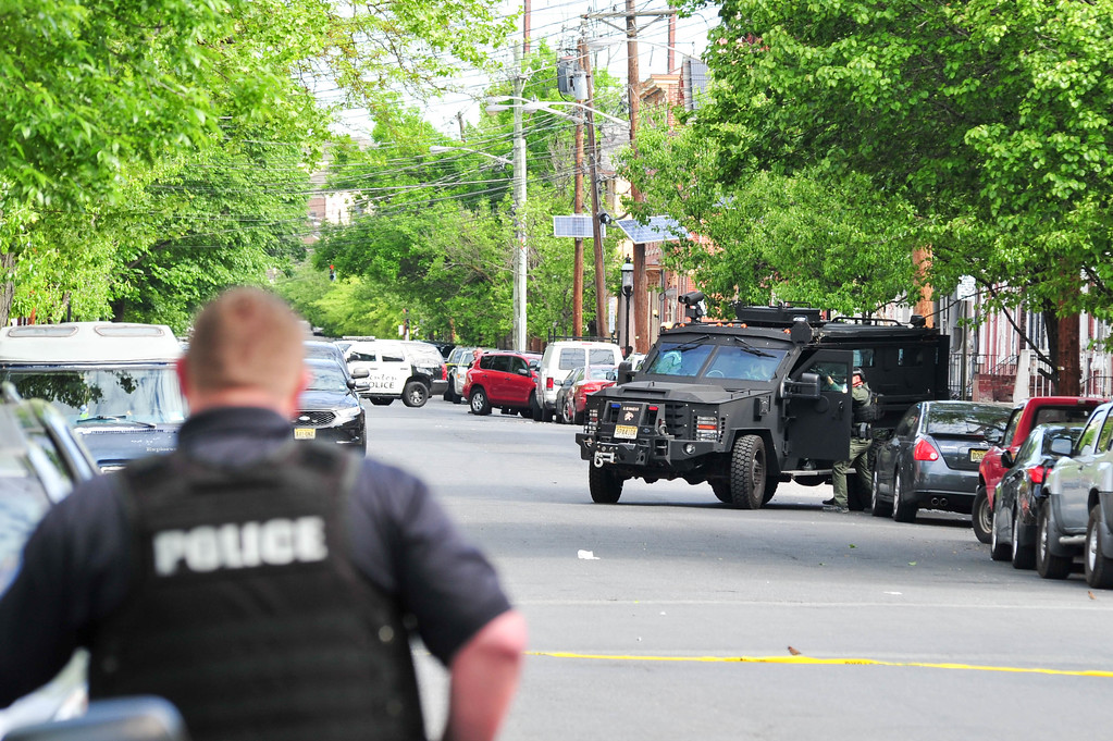 . A New Jersey State Police Bearcat is seen on Centre Street after a man barricaded himself inside of a house following a shootout with police. (Scott Ketterer - The Trentonian)