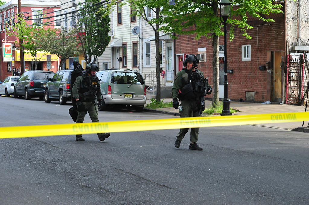 . New Jersey State Police  TEAMS unit officers are seen on Centre Street where a man had barricaded himself inside after a shootout with police on May 10, 2017. (Scott Ketterer - The Trentonian)