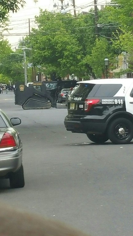 . Police use armored heavy equipment to clear space at the standoff.  L.A. Parker - The Trentonian