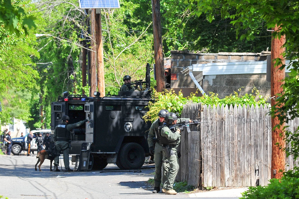 . New Jersey State Police  TEAMS unit officers are seen at the rear of 343 Centre  Street where a man had barricaded himself inside after a shootout with police on May 10, 2017. (Scott Kettterer - The Trentonian)