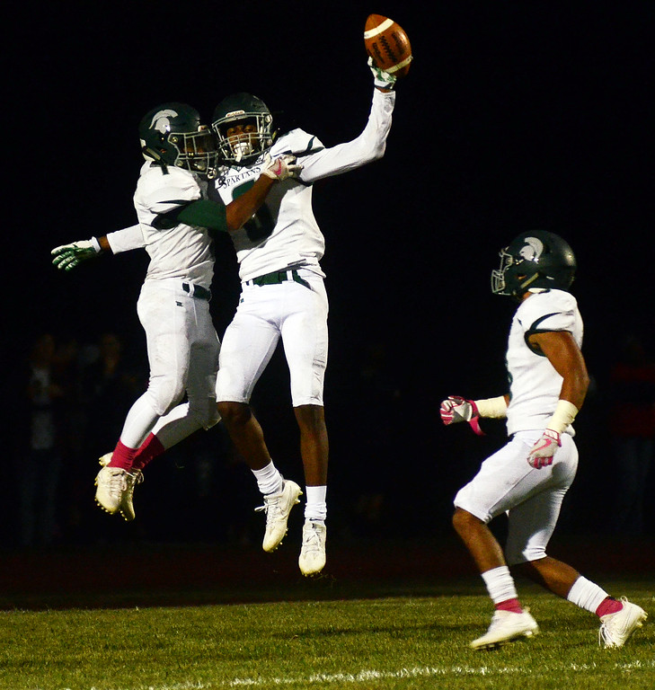 . Steinert`s Miles Smith holds up the football after scroring a touchdown against Allentown. gregg slaboda photo