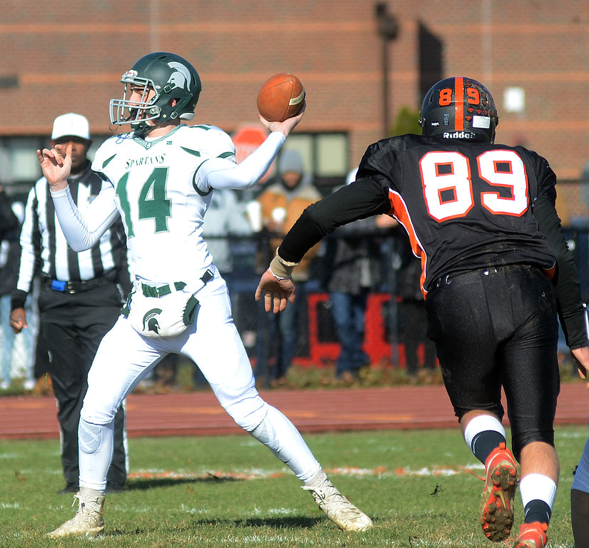 . Steinert` QB Colin Smith(l)throws a pass against Hamilton. gregg slaboda photo