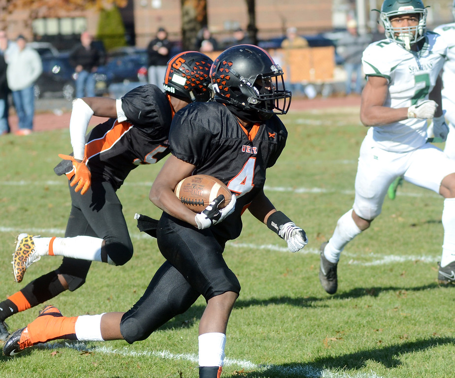 . Hamilton`s Kevin Boswell(l)carries the ball against Steinert. gregg slaboda photo