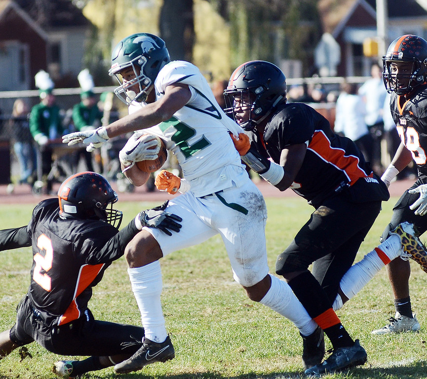 . Steinert`s Jordan Morrison(2) fights for yardage against Hamilton. gregg slaboda photo