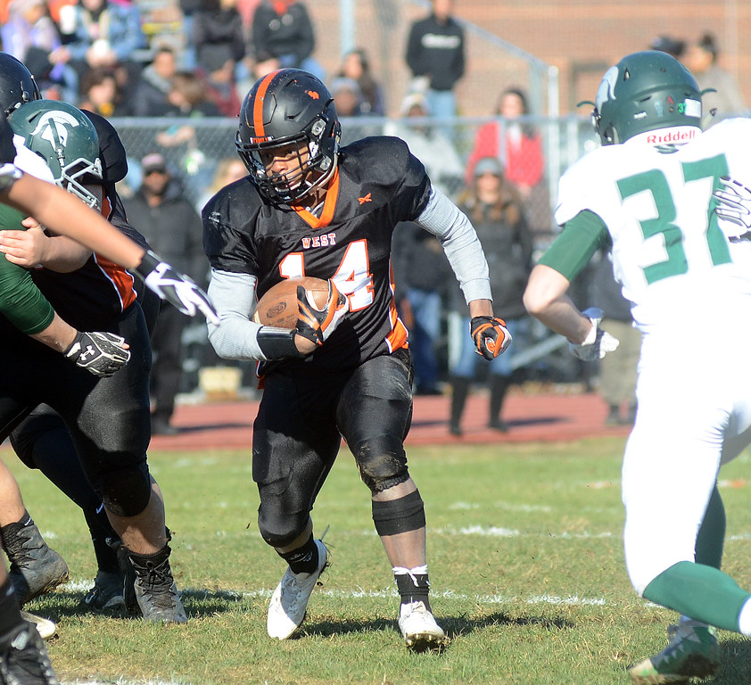 . Hamilton`s Cire Peters(c)carries the ball against Steinert. gregg slaboda photo