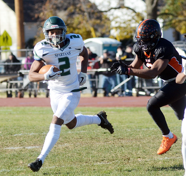 Steinert`s Jordan Morrison(l)on the run against Hamilton. gregg slaboda photo
