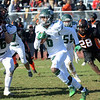 Steinert`s Miles Smith(c) picks up yardage against Hamilton. gregg slaboda photo