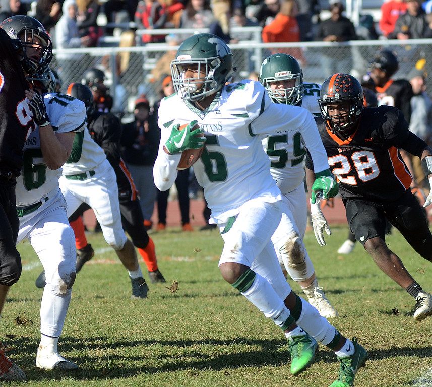 . Steinert`s Miles Smith(c) picks up yardage against Hamilton. gregg slaboda photo