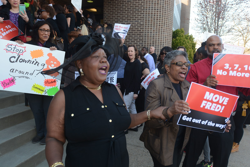 """TEA grievance chair Janice WIlliams leads the crowd outside the Board of Education building in chants of """"Move Fred, get out the way"""" before Monday's meeting. <br /> John Berry — The Trentonian"""