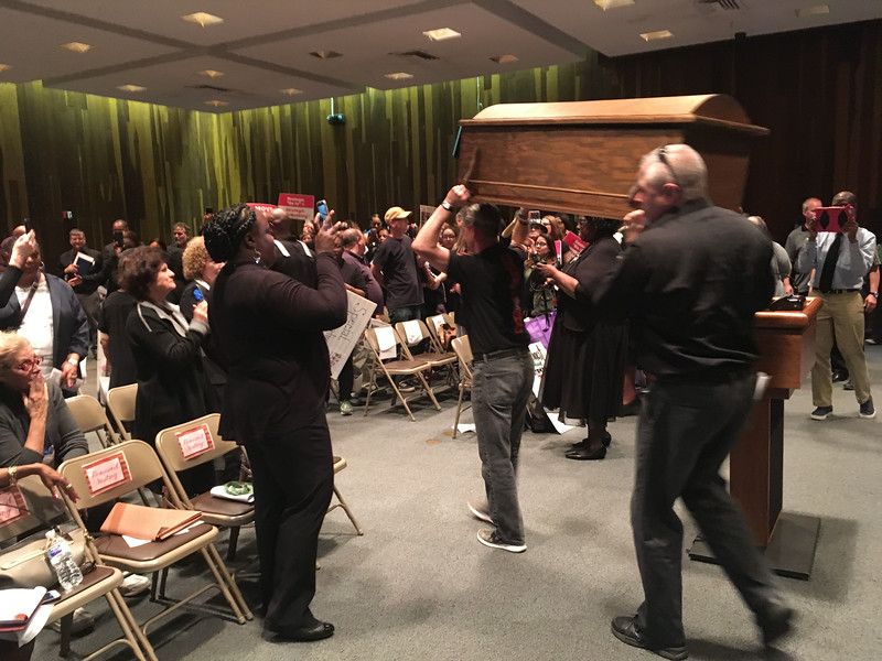 TEA protesters carry a fake coffin out of the Trenton Board of Education meeting Monday. <br /> David Foster — The Trentonian