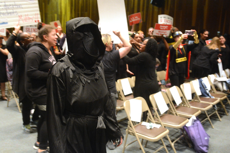 A woman dressed as the grim reaper stands with the TEA protesters before Monday's Trenton Board of Education meeting. <br /> John Berry — The Trentonian