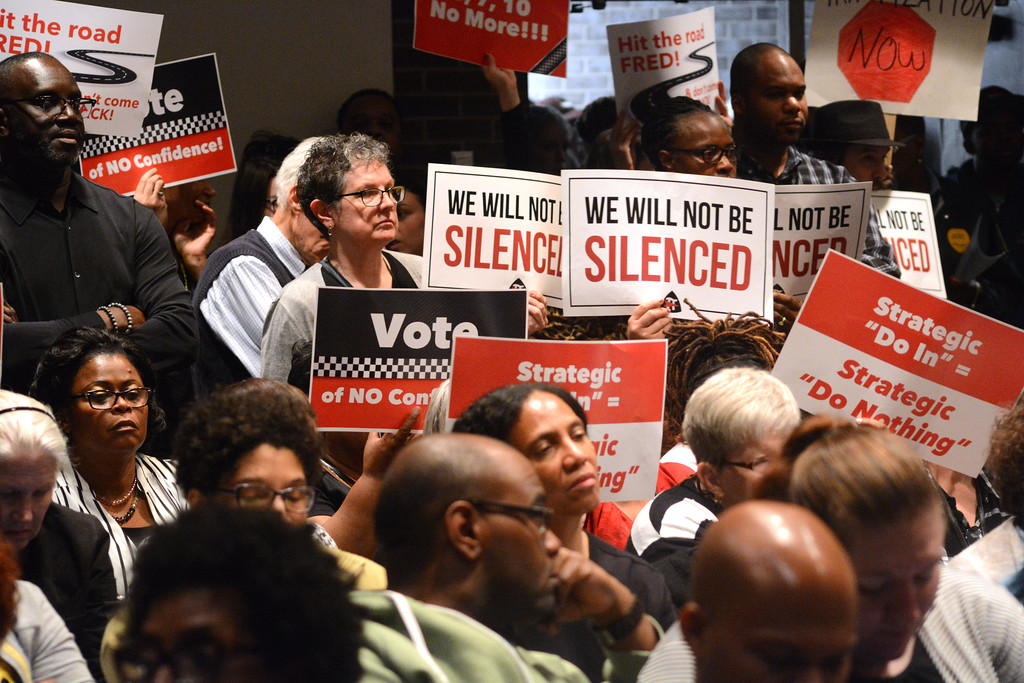 . Signs of protest at the Trenton Board of Education meeting Monday. 