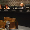 Superintendent Fred McDowell (second from right) reads his statement at the begining of the Trenton Board of Education meeting Monday. <br /> John Berry — The Trentonian