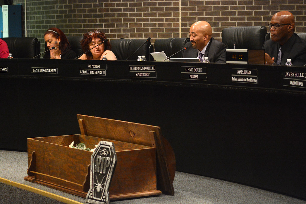 . Superintendent Fred McDowell (second from right) reads his statement at the begining of the Trenton Board of Education meeting Monday. 