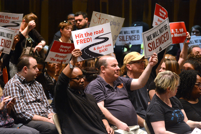 Signs of protest at the Trenton Board of Education meeting Monday. <br /> John Berry — The Trentonian