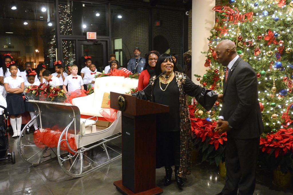 . Trenton�s Music Ambassador Sarah Dash talks with Mayor Eric Jackson during Trenton�s annual tree lighting ceremony on Wednesday. John Berry - The Trentonian