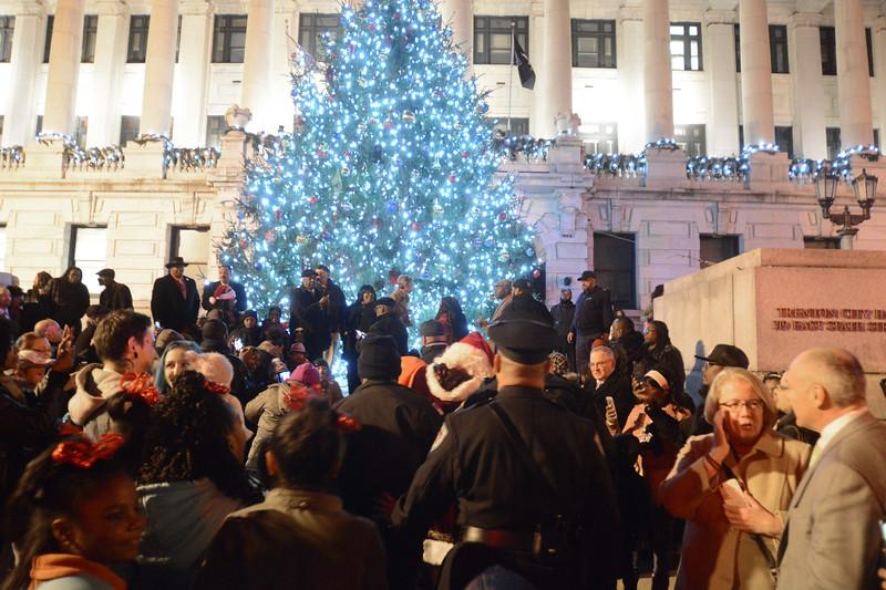 Santa gets a police escort to the Christmas Tree lighting ceremony in Trenton Wednesday night.<br /> John Berry - The Trentonian
