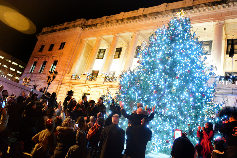 Trenton officials and residents joined together at City Hall Wednesday evening to light up the city's Christmas Tree.