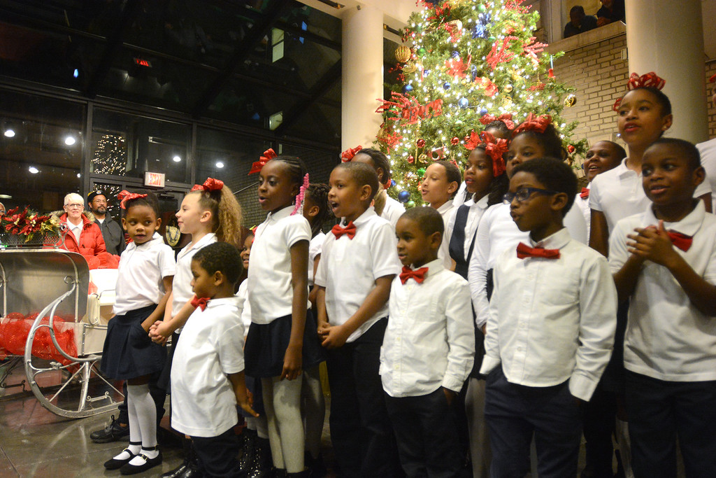 . Trenton youth sing Christmas carols during the city�s annual tree lighting ceremony. 