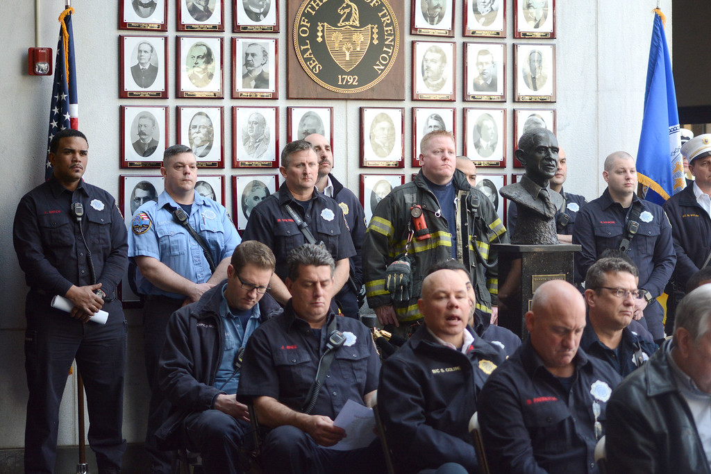 . Trenton firefighters listen during at the fire department�s annual Firefighter Memorial Service at City Hall Monday. John Berry � The Trentonian