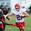 Lenape`s Jake Topolski (r) carries the ball against Trenton. gregg slaboda photo