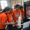 Trenton school kids check out a 3D printed object at the 2nd Annual Trenton Makers Day at the Roebling Wireworks Building on Friday. gregg slaboda photo