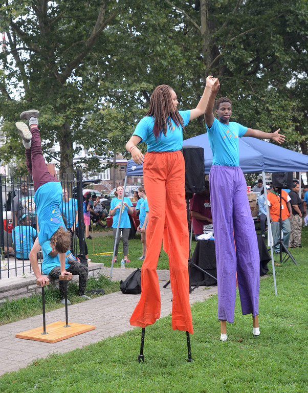 . Members of the Trenton Circus Squad perform at the National Night Out event at Columbus Park. 