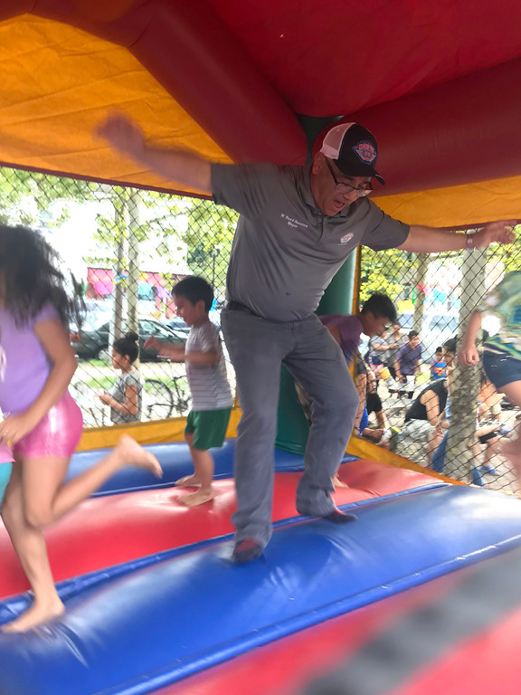 . Trenton Mayor Reed Gusciora takes a turn in the bounce house at the National Night Out event at Agabati Square Park. John Berry � The Trentonian