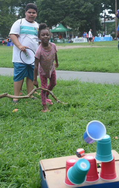 Avyon Melvin, 7, of Trenton hits her target in one of the games at the National Night Out event at Columbus Park. <br /> John Berry — The Trentonian