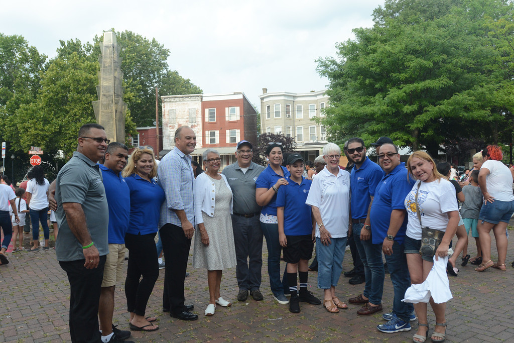 . Trenton and area dignitaries pose for a photo at the National Night Out event at Agabati Square Park. John Berry � The Trentonian