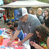 Trenton Mayor Reed Gusciora takes part in the arts and crafts portion of the festivities at the National Night Out event at Agabati Square Park. <br /> John Berry — The Trentonian