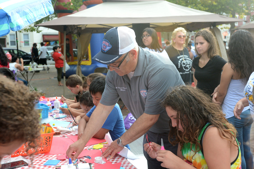 . Trenton Mayor Reed Gusciora takes part in the arts and crafts portion of the festivities at the National Night Out event at Agabati Square Park. John Berry � The Trentonian
