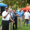 Trenton Council Member Duncan Harrison talks to the crowd at a National Night Out event at Columbus Park in Trenton Tuesday. <br /> John Berry - The Trentonian