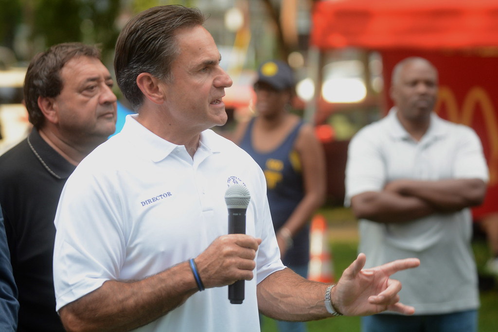 . Trenton Police Director Ernie Parrey talks about community policing at the National Night Out event at Columbus Park in Trenton Tuesday. 
