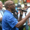 Mercer County Freeholder Sam Frisby talks to the crowd at a National Night Out event at Columbus Park in Trenton Tuesday. <br /> John Berry - The Trentonian