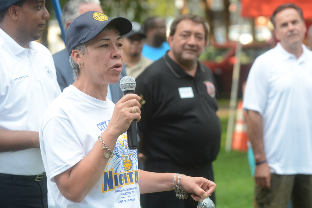 . Trenton Mayor�s chief of staff Francis Blanco talks to the crowd at a National Night Out event at Columbus Park in Trenton Tuesday. 