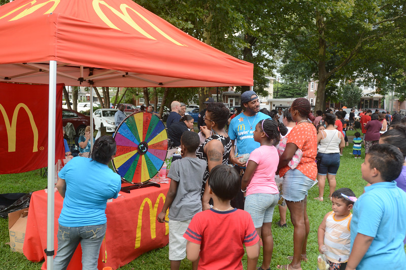 Lines were long for the giveaway tents at the National Night Out event at Columbus Park in Trenton Tuesday. <br /> John Berry - The Trentonian